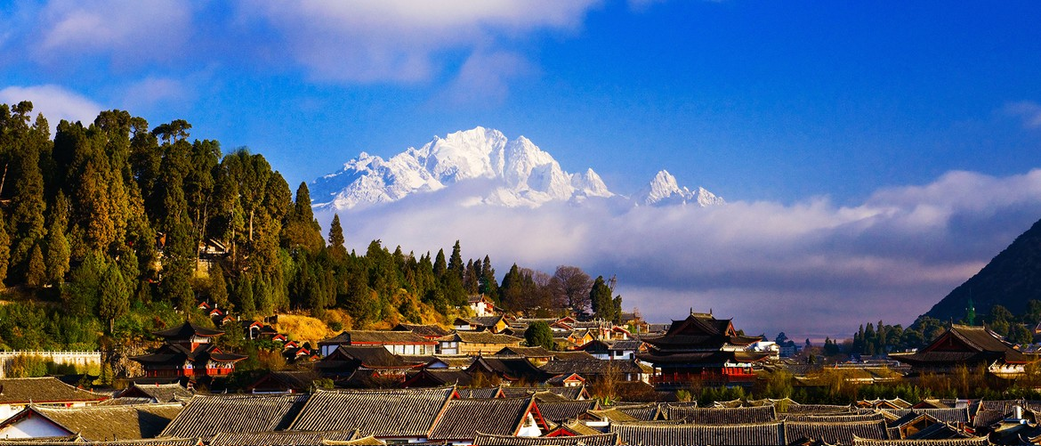 Lijiang old town. You can see Jade Dragon Snow Mountain in the distance.