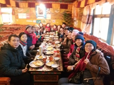 They are enjoying tasty breakfast at the rongbu guest house.
