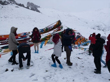 They are visiting the prayer flags in Largunla pass