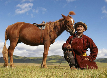 Tibetan Nomads with their horse.