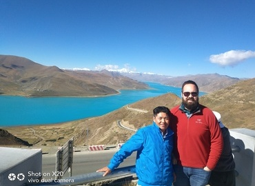 Our Tibetan tour guide and guest posed for a picture beside the beautiful Yamdrok Lake.